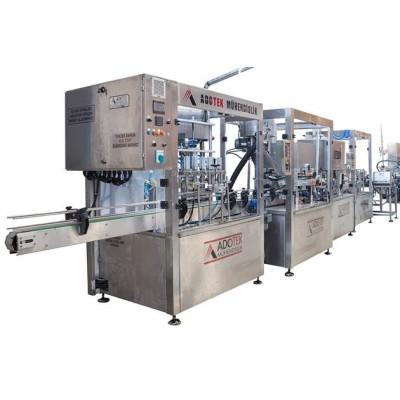 ADK 301 Servo Motorlu Dolum, Kapaklama ve Etiketleme Makinası