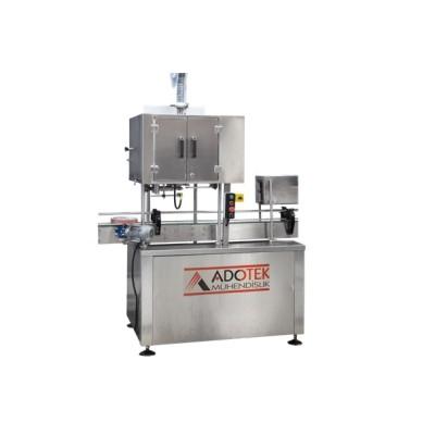 ADK 309 Sleeve Etiket ve Kapşonlama Makinası